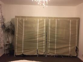 2 cream canvas wardrobes with shelf storage