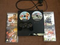 PS3 console slim edition with 6 games