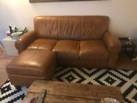 Three seater leather sofa and footstool