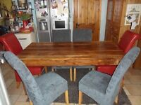 Solid Walnut Table and 6 Chairs for sale.