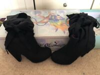 Irregular choice heel boots