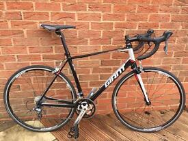 Giant defy road bike , size medium large .
