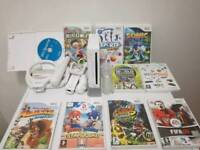 Nintendo Wii console with 10 games and accessories in excellent condition