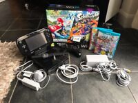 Wii U 32gb premium pack with 4 games, an extra controller and all cables + original package