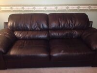 Chocolate brown 2 sitter settee (easily seats 3)