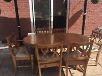 Ducal extending dining table and 6 chairs. Good condition.