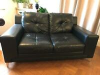 Black leather 2 seater sofa -nice condition & comfy