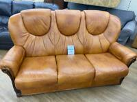 Traditional style tan leather three seater sofa