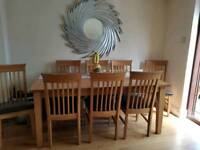 Dining table which extends with eight chairs