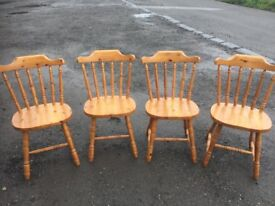set of four solid pine dining chairs