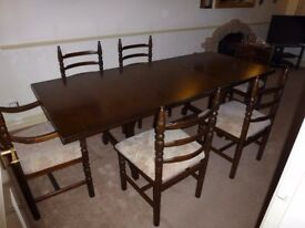 Solid Dark wood Table and six Chairs