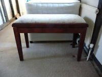Piano stool. Seat lifts up to store music etc. Very good condition.