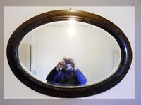 Vintage bevel edged oval mirror in dark wood
