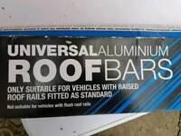 Universal roofbars for raised roof rails