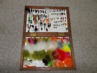 Assorted trout flies and lures in wooden box