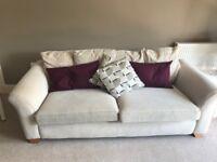 Comfy three-seater cream sofa