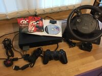 Sony Playstation 2 with force feedback stearing wheel and game...