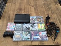 PS3 slim 12gb with games and Singstar games and mics - £80