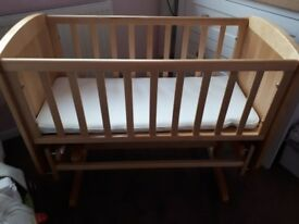 Swinging crib (can also be static) with new mattress.