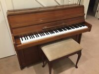 Bellette upright piano for sale. Good condition; piano stool included.