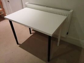 Height adaptable table