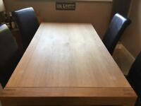 6 seater oak dining table and 4 high back chairs