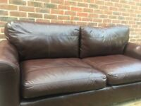 Three seated chocolate leather sofa plus arm chair