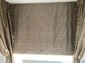 Lovely quality blackout roman blind - matching curtains available. Professionally made.