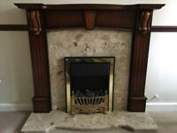 Fire surround and cream conglomerate hearth and back panel