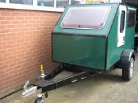 Teardrop type sleeping pod trailer.