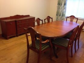 Dinning room table and 6 chairs with matching side cabinet