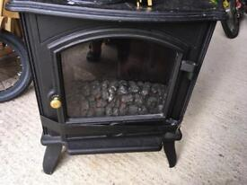Remote controlled electric stove/wood burner