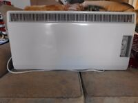 Electric wall mounted convection heater Dimplex with timer excellent condition.