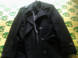 Black Wool Overcoat for sale medium size 34-36 hardly worn.