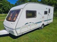 Immaculate condition Swift Challenger four berth caravan with motor mover and air awning
