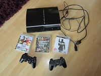Sony Playstation 3 with 2 controls and 3 games, very good condition