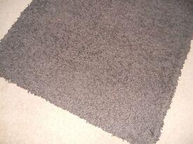 Rug, dark brown, long pile