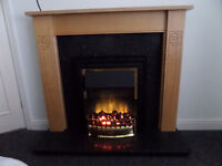 Dimplex Electric fire with surround and granite inset/harth