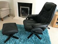 Black leather armchair and stool