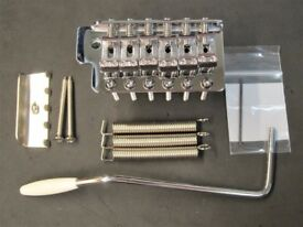 Fender MIM Stratocaster stamped bridge with fixings and tremelo arm.