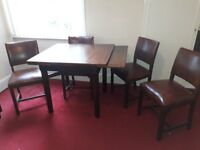 Vintage 1940s Utility solid wood dining room suite comprising table and four chairs and sideboard.