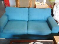 M+S Teal coloured 3seater material sofa, 1yr old in great condition