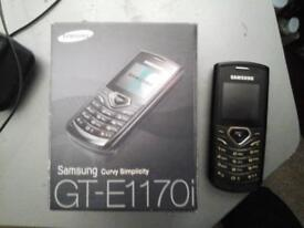 SAMSUNG GT E1170I ON ANY NETWORK COMES WITH BOX AND CHANGER £ 5 NO TEXTS PLEASE
