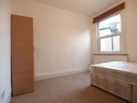 A large modern 4 bedroom flat with a garden within a 10 minute walk of Manor House tube