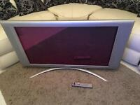 Philips 42 inch tv in silver with remote, power cable, stand and wall bracket.