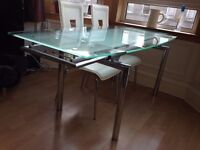 Extendable tempered glass and chrome dining table £175 ono.