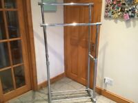 Height adjustable to over 5 feet-a double bar clothing rail-lightweight-£20