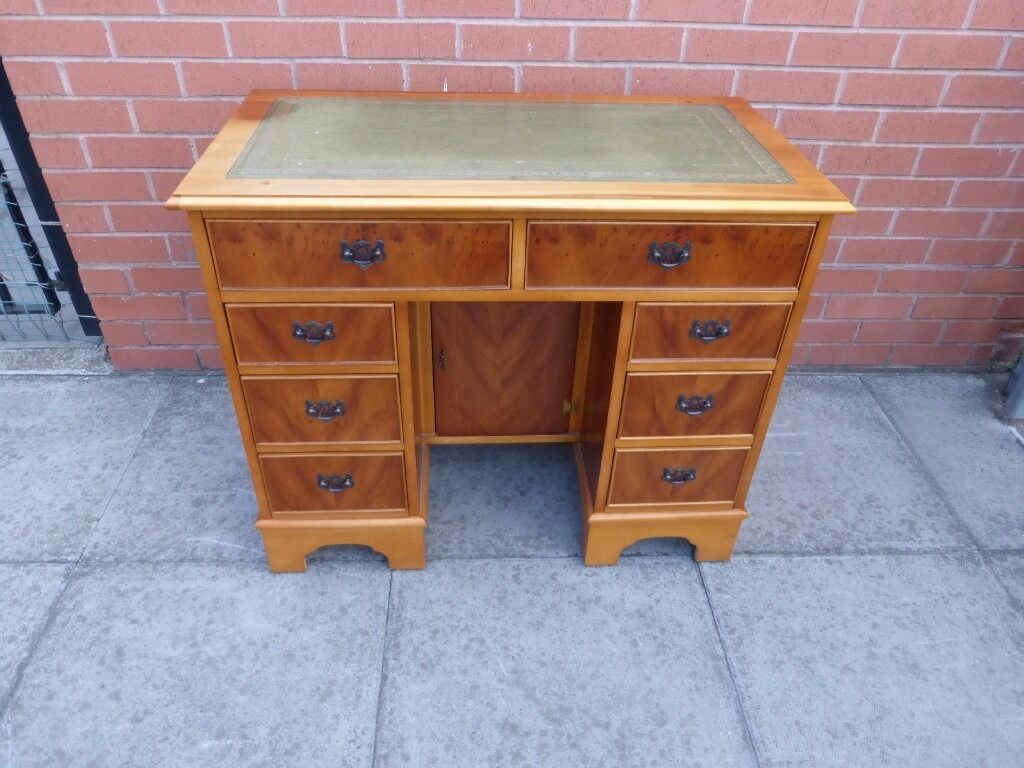 A variety of leather inlay twin pedestal desks