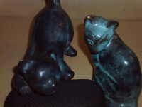 a pair of bronze cats