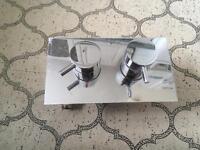 Chrome wall mounted bath mixer controls
